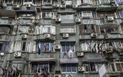 A building in China marked by several window-unit air conditioners. AC units like these can cause moisture buildup and offer the bacterium that causes legionnaire's disease a habitat in which to multiply.